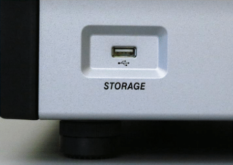 USB connection on the bottom left corner of the front of the Spectrum Compact CE System